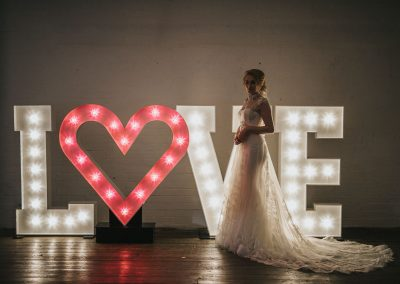 Bride with light up letters of LOVE with heart shape from Ray of Light Letters, Lincolnshire and Yorkshire