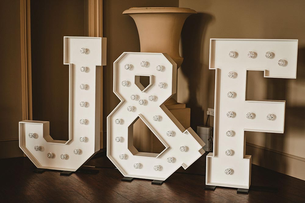 Small light up letters initials of bride and groom