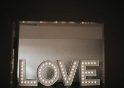 Large marquee light up letters of the word LOVE in modern font