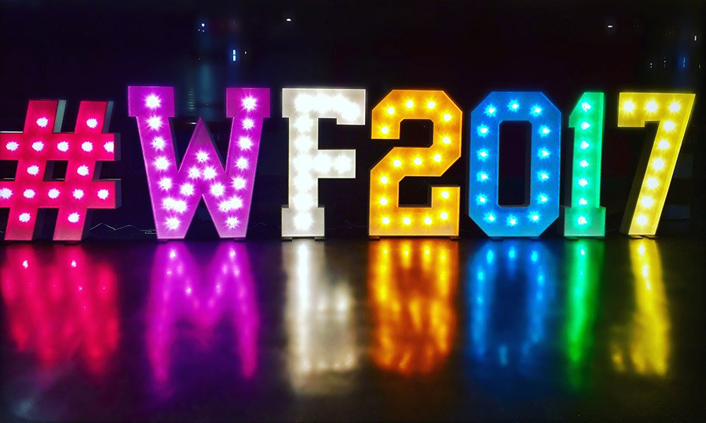 Celebrate important business dates with large multi coloured light up letters