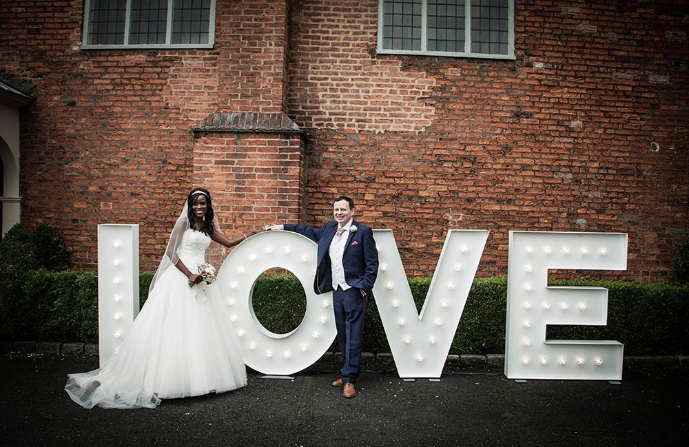 Large light up letters spell the word LOVE