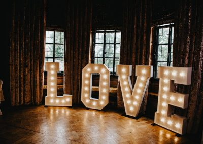 Vintage word LOVE written in giant light up letters
