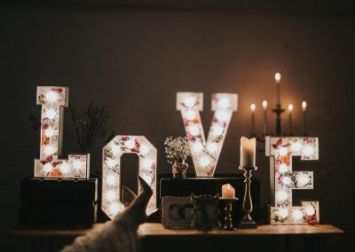 Bride relaxing with small light up letters of LOVE from Ray of Light letters, Lincolnshire and Yorkshire