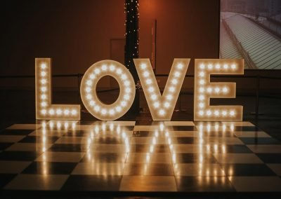 Shiny reflections of the word LOVE in light up letters from Ray of Light Letters, Lincolnshire and Yorkshire